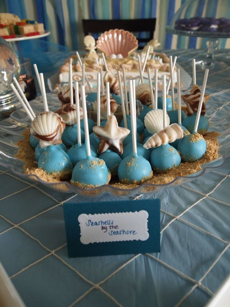 "Under the sea themed Cake pops. Use graham crackers for ""sand"""