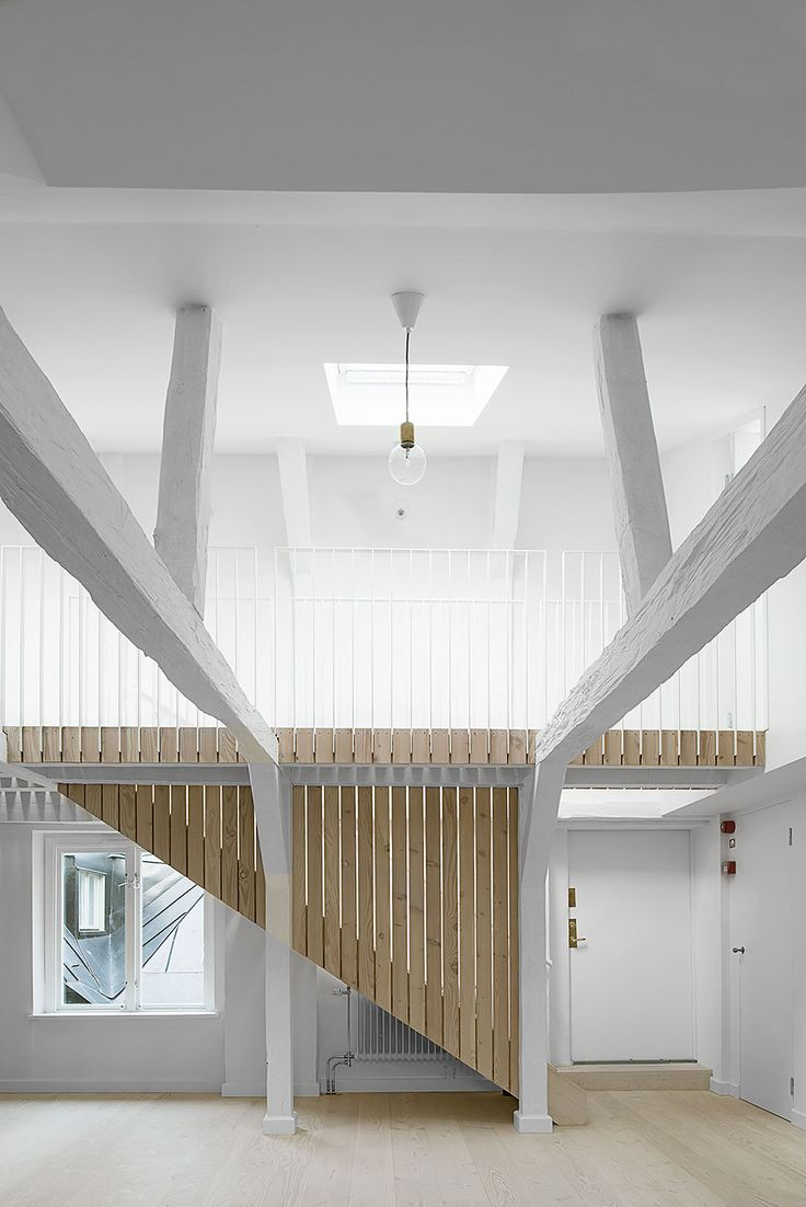 Studiomama / loft apartments; white steel flat bar balustrade detail integrated with cladding and floor boards