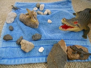 Items to provide that help kiddos create a zoo at block centers (towel = water; fake plants = animal food)