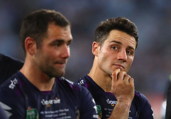Cooper Cronk Photos Photos - Cooper Cronk of the Storm looks dejected after the 2016 NRL Grand Final match between the Cronulla Sutherland Sharks and the Melbourne Storm at ANZ Stadium on October 2, 2016 in Sydney, Australia. - 2016 NRL Grand Final - Sharks v Storm