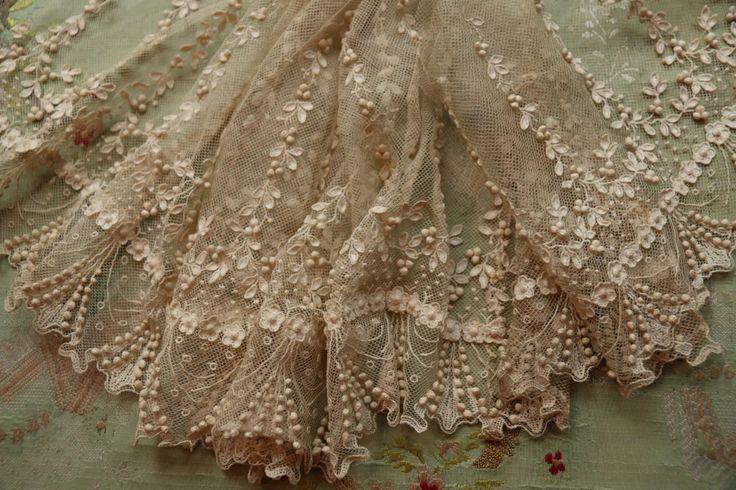 Dainty antique lace flounce More