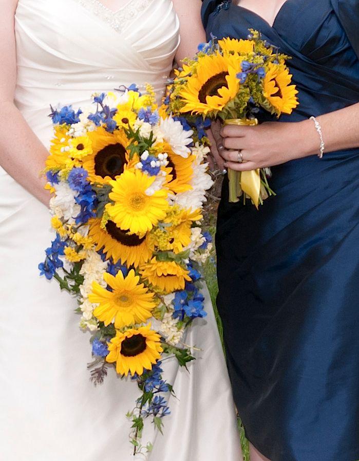 A Vows, Estes Park Original - Yellow Sunflowers, Black Eyed Susans, Gerbera Daisies, Blue Delphinium and White Roses