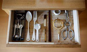 Utensils lie in a kitchen drawer in the home of minimalist Saeko Kushibiki in Fujisawa, south of Tokyo. #minimalism