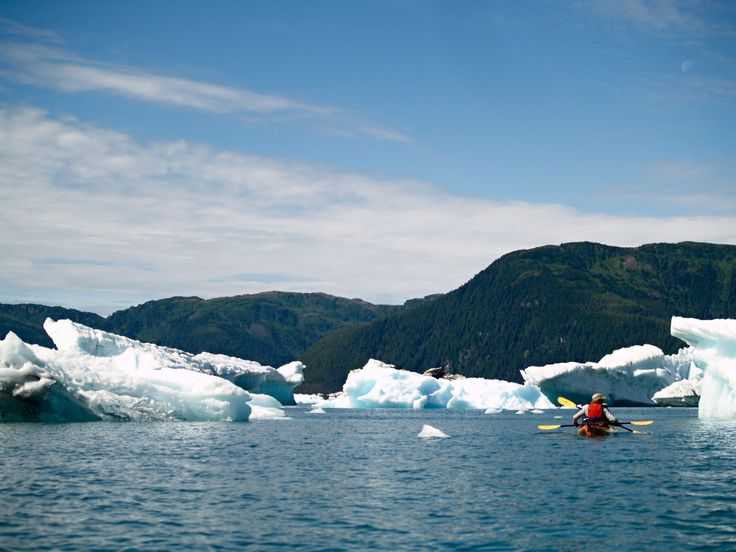 Kayak around iceberg. Our photographs are FREE and you can use them for web sites, mobile apps, image Placeholders, all private or commercial works etc. If you have any questions, write to info@freephotodb.com.