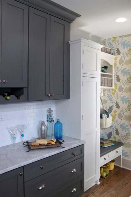A buffet counter sits at a lower height (33 inches) than the rest of the counters and has a marble top that gives it an offset look (great for rolling dough). Long and wide drawers below provide storage for casserole and baking dishes.