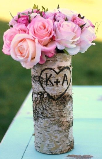 Birch-bark hollowed out, carved, filled with a vase of flowers. I love