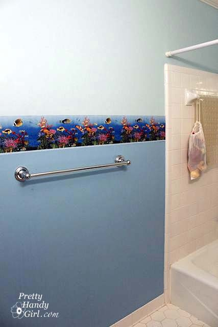 Remove wallpaper borders-- with fabric softener, no less. May want to refer to this for re-doing downstairs bathroom