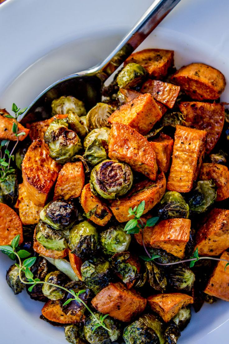 Roasted sweet potatoes and brussels sprouts: It's what's for dinner.  Get the recipe.