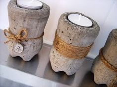 concrete votive holder -- looks like it's made from the bottom half of a plastic soda bottle