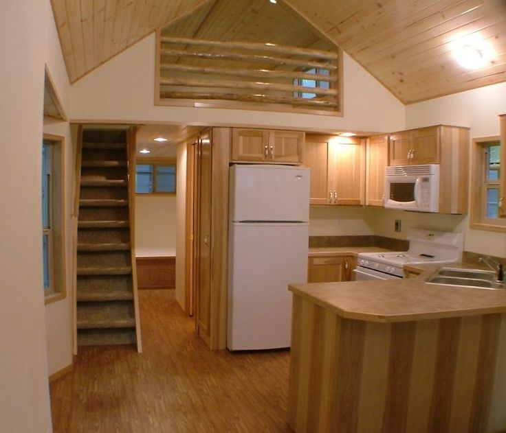 """I'm excited to share this park model tiny cabin on wheels by Rich's Portable Cabinscalled Dodge. It's 11' 6"""" wide and 33' 10 1/2"""" long plus it has an additional covered porch for your outdoor spac..."""