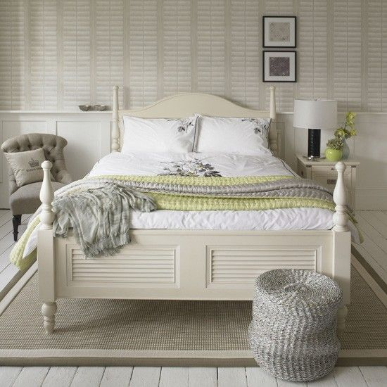 Love this wallpaper pattern looks like shutters, very effective add painted white timber floor, white slat bed for the beach home look -Calm white bedroom