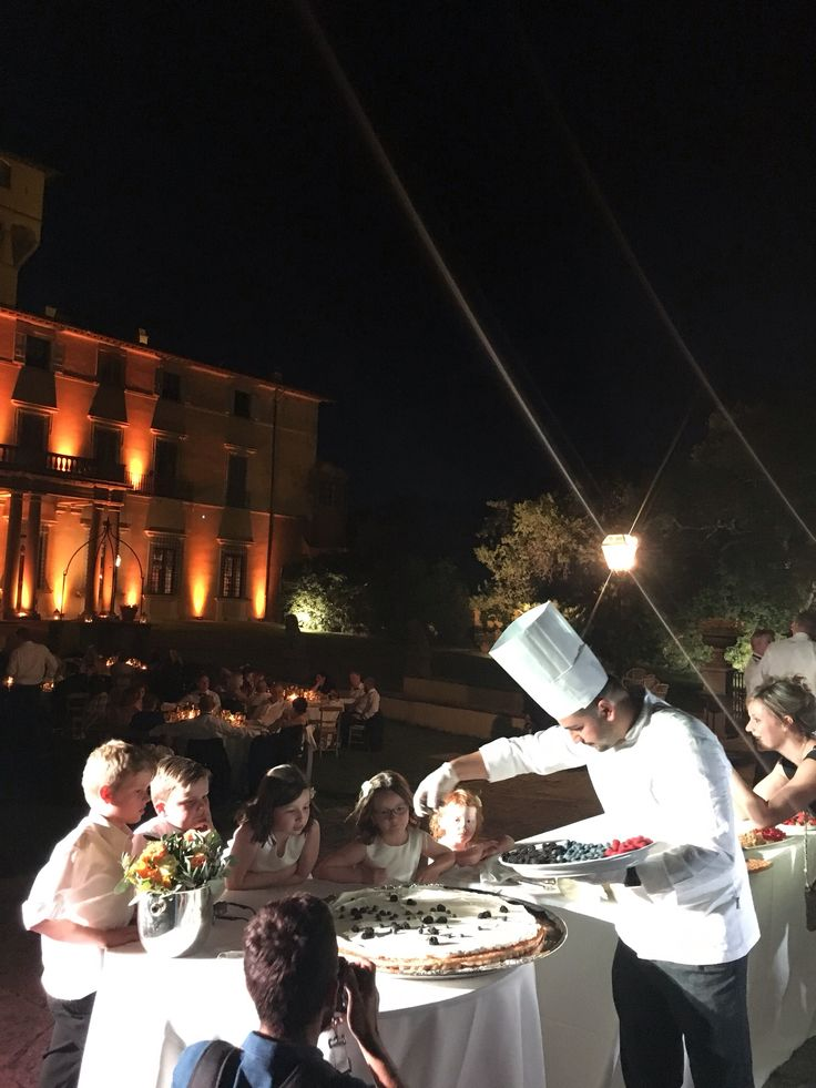 Cake moment for the Bride and Groom with the best guests admiring the Chefs Wedding cake Millefoglie a Vista at Villa di Maiano with Wedding Italy