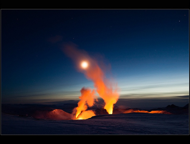 """A place called Víti, meaning """"Hell"""" and Viti is a volcanic crater. However you can see the geothermal power plant Krafla. The steam is just illuminated by artificial light.    It looks like a volcanic eruption, doesn't it?"""