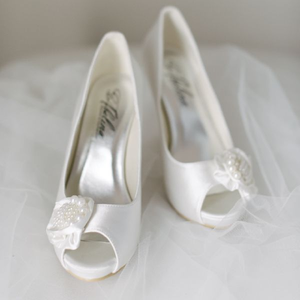 Pearl Wedding Shoes by Pearl & Ivory ®  - Find more elegant wedding shoes from our collection www.pearlandivory.com/bridal-shoes.html. Photography by Yolande Marx #PearlandIvory #Pearl #WeddingShoes #peeptoe #BridalShoes