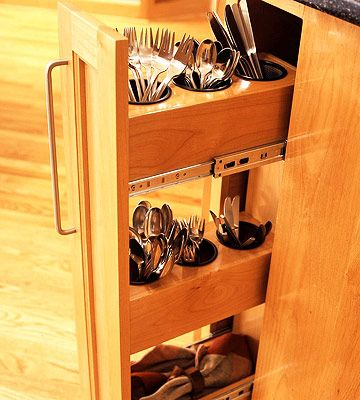 Maybe I pinned this before too...?  I love the idea of vertical storage!    Flatware In Easy Reach:  Adapt restaurant-style equipment to keep everyday utensils handy and organized. When entertaining, take caddies and contents to the table. If a skinny pullout is unavailable, adopt the same vertical storage principles by keeping flatware organized in jars in cupboards.
