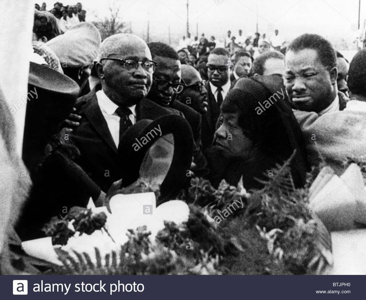A mourning Reverend Martin Luther King Sr., Alberta Williams King, and A.D. King, at the funeral for Dr. Martin Luther King Jr.
