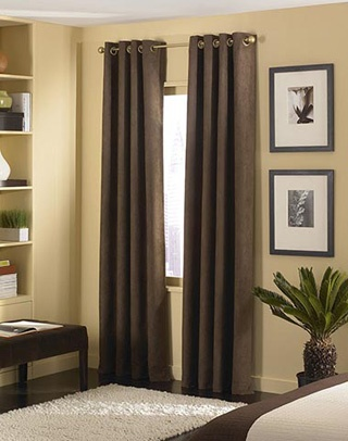 Brown curtains, warm yellowish-beige walls, white area rug