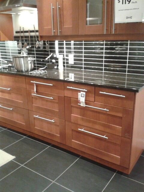 Adel medium brown cabinets with a eye catching backsplash for Adel kitchen cabinets ikea