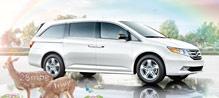 Honda Odyssey is the minivan I want.  It has 8 seats and 28 mpg.  Idealy in smokey topaz exterior and truffle fabric interior