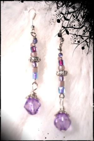 """""""ROMANTIC IN VIOLET"""" DANGLE EARRINGS      Beautiful shades of soft violet colours' prevail in these romantic earrings.  Glass Faceted Bicones feature as the """"Focal"""" and various shades of violet Miyuki Squares and Rounds  accenttheses earrings combined with Silver Bali Spacers and Bead Caps."""