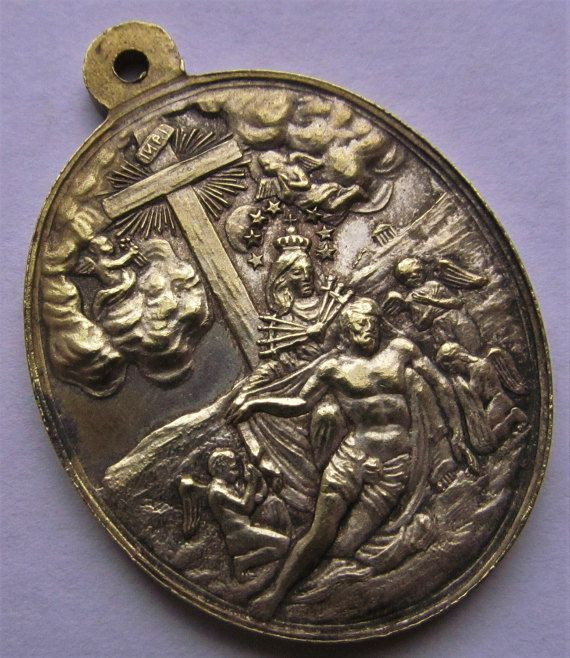 Antique French Virgin Mary Sorrowful Mother And Jesus At The Cross 1080 Indulgences Religious Medal This is an exquisite antique French religious medal Circa 1800s  The front depicts the moving image of the Virgin Mary as The Sorrowful Mother at the cross with Jesus draped across her lap. Seven swords pierce her heart as a group of angels mourn beside her.  The reverse text in French says that 1080 indulgences will be given to who ever recites the Hail Mary before this holy image. Measures 1…