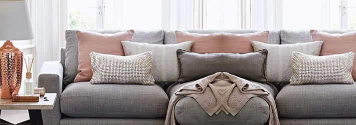 Feminine living room with hints of copper, pink and taupe from House of Fraser.