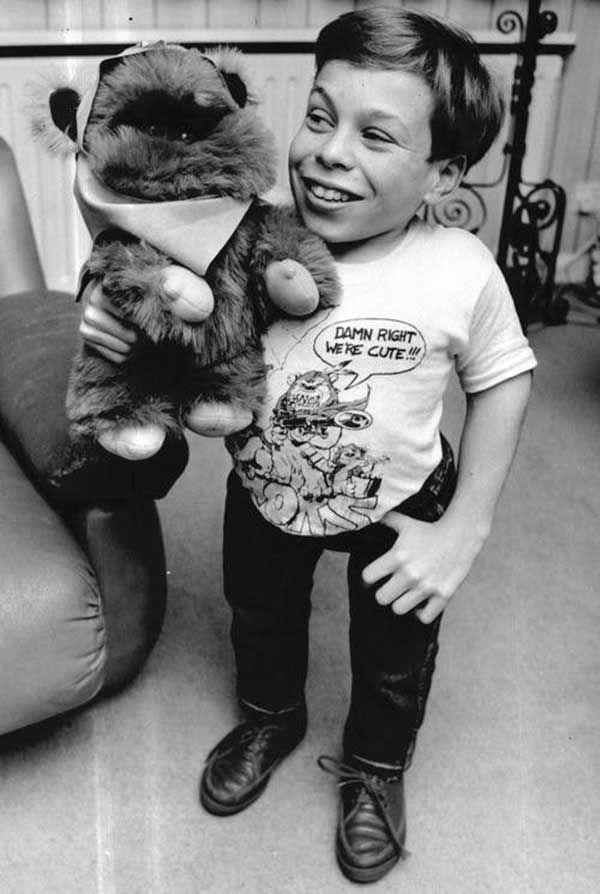 A young Warwick Davis with a stuffed Ewok