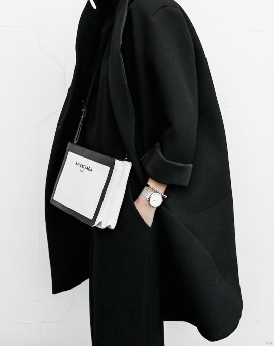 Black oversized blazer inspired coat with black pants and black & white Balenciaga crossbody bag.