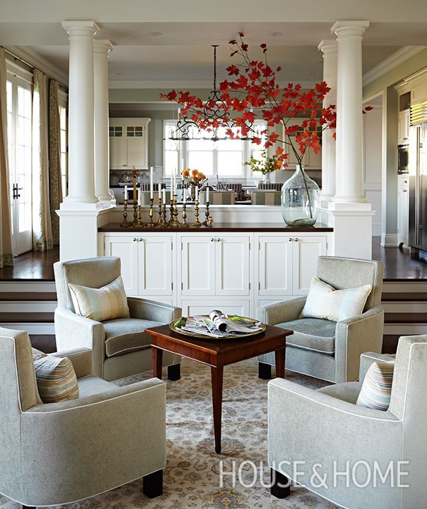 Built-in cabinets topped by Tuscan columns separate — but don't visually close off — the kitchen and dining room from the great room.   Photographer: Angus Fergusson   Designer: Sarah Richardson and Natalie Hodgins