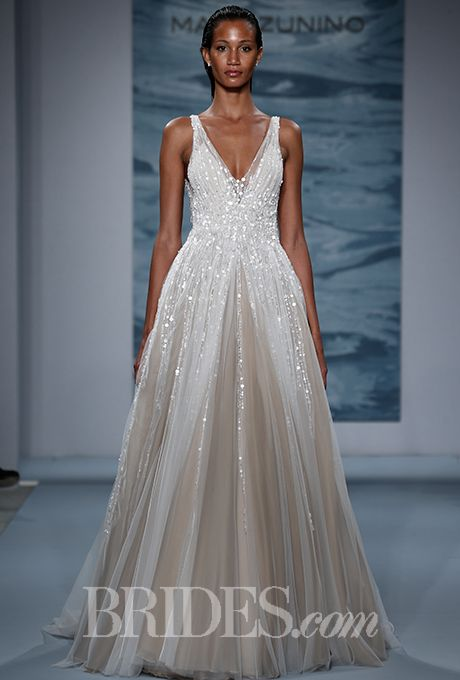 Brides.com: . Trend: Deep V. Style 132, sleeveless beaded tulle A-line wedding dress with a v-neckline and nude details, Mark Zunino