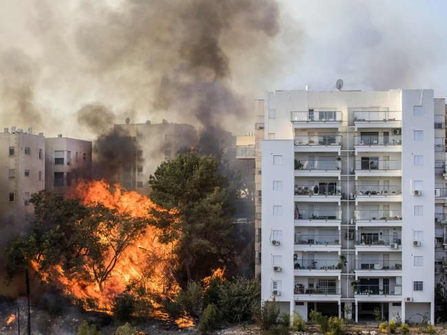 Homes were threatened as fires raged in Haifa. Picture: AFP/Jack Guez