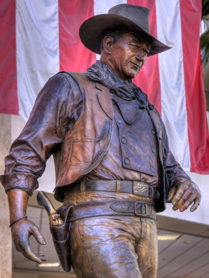 A close up of the statue of John Wayne at the John Wayne Airport in Orange County, California.