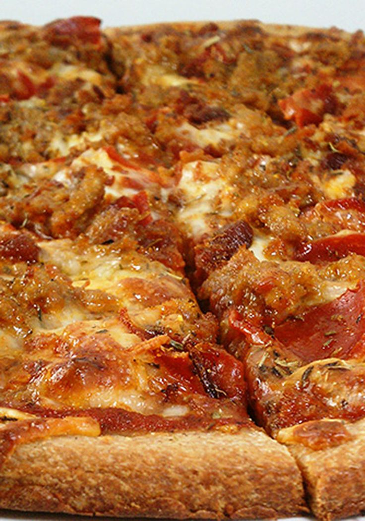 Saucy, cheesy pizza piled with sausage, pepperoni and bacon doesn't have to wreck your healthy eating plan. This recipe from Emily Koenigsberg, who posts good-for-you recipes at EmilyBites.com, uses hot Italian turkey sausage, whole wheat pizza dough, reduced fat mozzarella cheese, turkey pepperoni and, yes, real crumbled bacon bits (a little bit goes a long way).