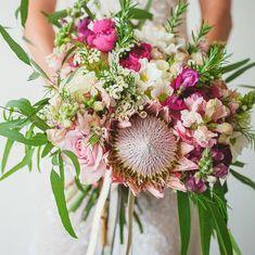 unique wedding bouquet of king protea, Australian greens and tillandsia.