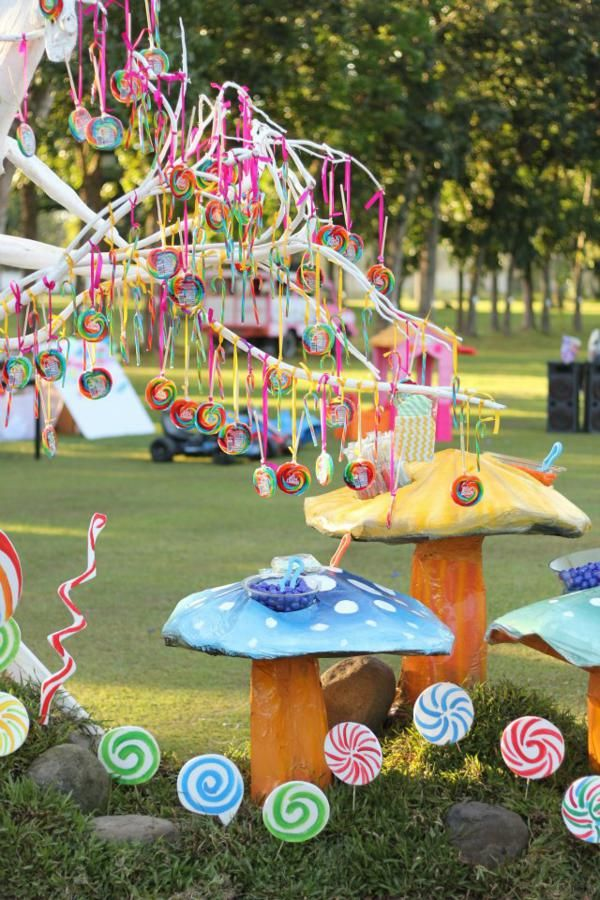 Willy Wonka Party via Kara's Party Ideas | We could spray paint fallen branches white and hang candy from them as centre pieces instead of a big tree