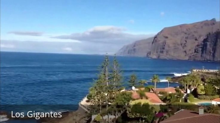 "Places to see in ( Los Gigantes - Spain )  Los Gigantes is a resort town in the Santiago del Teide municipality on the west coast of the Canary Island Tenerife. Los Gigantes main feature are the giant rock formations Acantilados de Los Gigantes that rise from the sea to a height of 500-800 metres (16402625 ft) after which the town has been named. Los Gigantes means ""The Giants"".  Nearby to the south are the resorts of Puerto de Santiago and Playa de la Arena. 3 kilometres (1.9 mi) to the…"