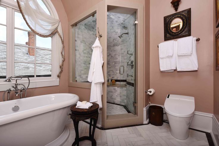 Master Bath by Chad Graci, Graci Interiors LLC, featuring St. George Freestanding Soaking Tub, Transitional Floor Mounted Bathtub Faucet with Randall Lever Handles, AT200 Spalet Toilet  and Randall Robe Hook.