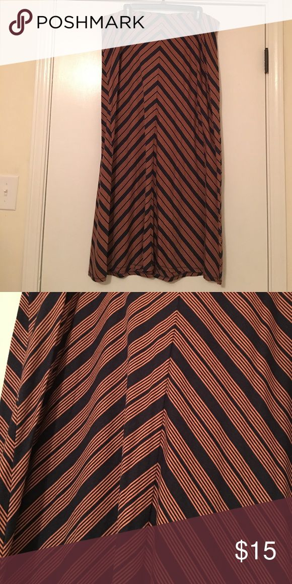 Long chevron style skirt Light orange color stripes and navy contrast. Long skirt in great condition. I wore this with a navy shirt tucked in with sandals on a cruise! Loved it! Super comfy! Sonoma Skirts