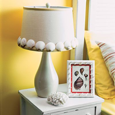 Decorate lampshade with shells from the beach.