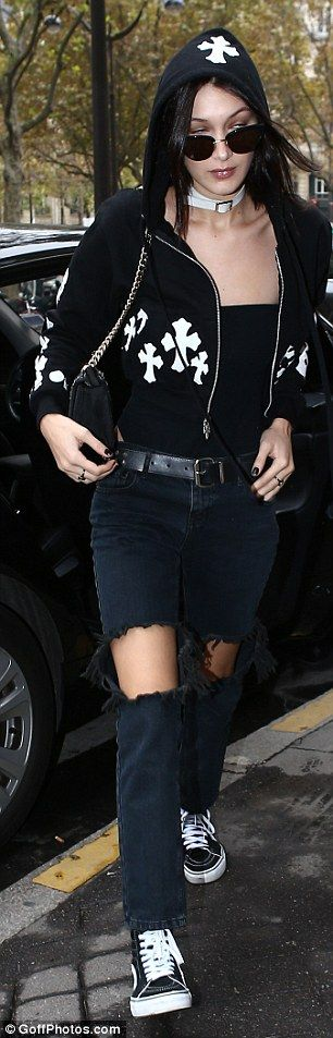 Rock chic: Adding a touch of rock-chic she added a metal-studded belt and rocked a black Gothic manicure