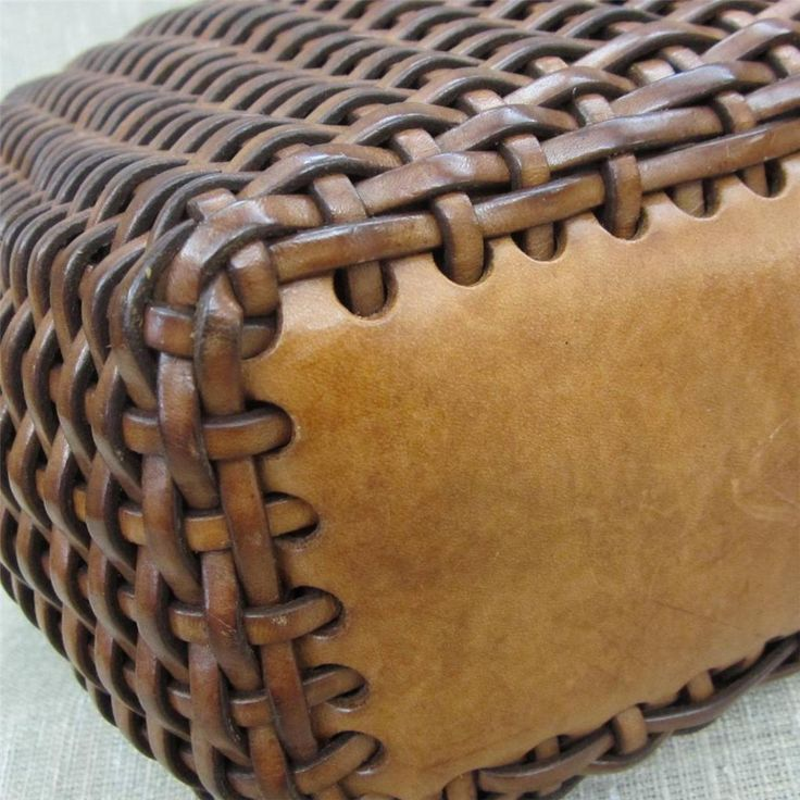 Woven leather bag: Start with thick , perforated leather rectangle for the bottom.