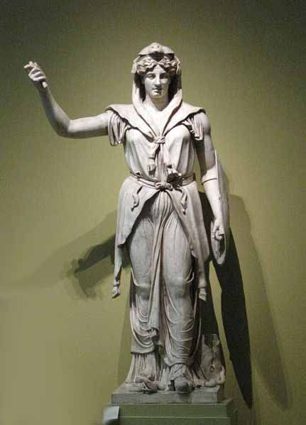 """Protector and special counselor of the Roman state and queen of the gods. She is a daughter of Saturn and sister (but also the wife) of the chief god Jupiter and the mother of Juventas, Mars, and Vulcan. As the patron goddess of Rome and the Roman empire she was called Regina (""""queen"""") and, together with Jupiter and Minerva, was worshipped as a triad on the Capitol (Juno Capitolina) in Rome."""