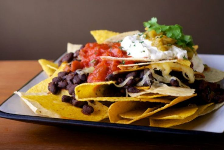 Get your home tailgate on with this delicious nacho dish!
