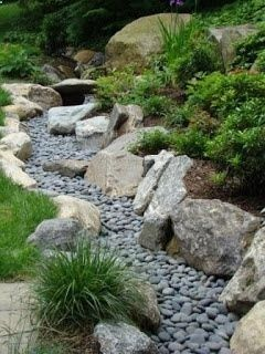 Love this dry stream--great idea for runoff from a slope as suggested or in my case from our geothermal system. By Jan Johnsen/Serenity in the Garden