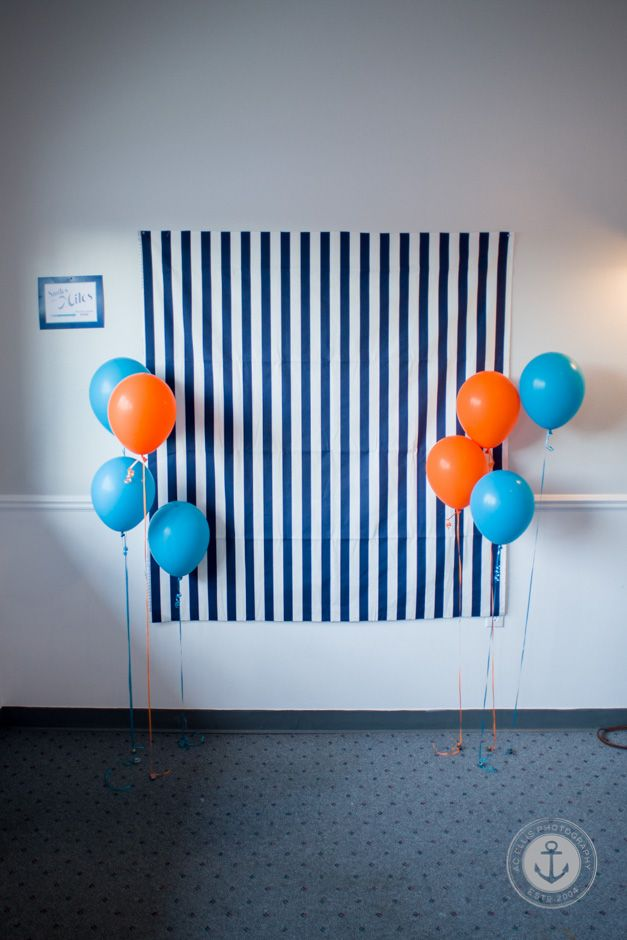 Make a homemade photo booth!  Patterned sheet for backdrop, plum balloons or paper lanterns, twinkle lights and tulle. Fancy seat?