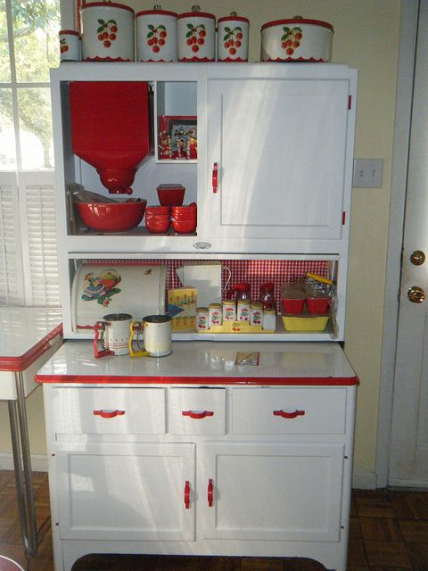adorable Hoosier and all the accessories, love those cherry storage tins on top too.  How sweet