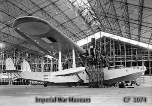 British mechanics inspecting a captured Japanese Emily H6K flying boat, Sourabaya, Java, Jan 1946