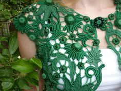 Irish crochet -- Style uses chunky motifs and wider netting.  Color, vs. white or black.