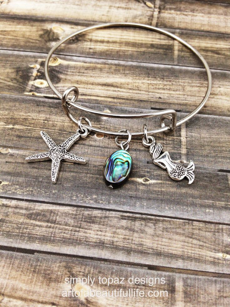 Beach Charm Bracelet, Mermaid Jewelry, Mermaid Bracelet, Starfish Bracelet, Expandable Bracelet, Mermaid Jewelry, Beach Bracelet, Abalone by simply topaz   https://www.etsy.com/listing/251252275/beach-charm-bracelet-mermaid-jewelry