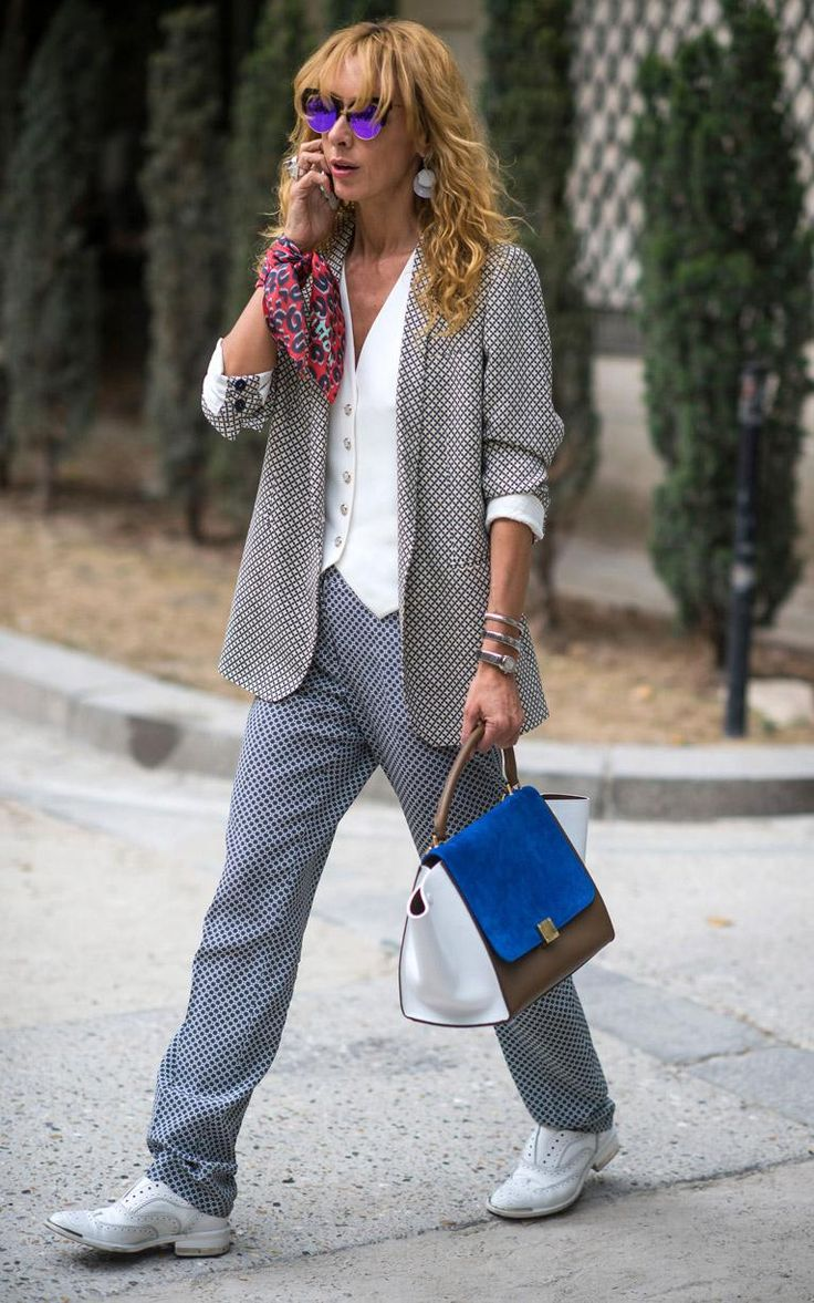 """""""Give neckerchiefs a new lease of life by tying them around your wrists, like Elina Halimi."""" Also, city suiting moderne. The Daily Telegraph July 2015, photo credit Rex"""